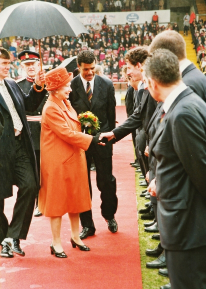 Her Majesty being introduced to the playing staff.